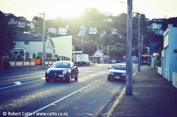 Out for a late afternoon walk in Seatoun this week, testing how the 40mm Summicron-C lens would flare when pointed into the sun - not bad, I thought - and this cute little Alfa Romeo MiTo happened to drive through the shot at the time.  First one I've seen in the flesh - I was hoping it'd look a little bit more like their 8C, but it's not bad for a real-world small car…