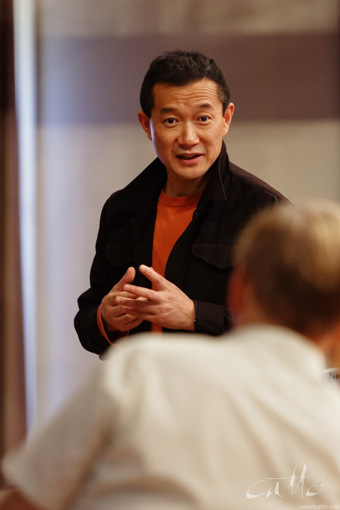 Tan Dun speaking to Jack Body at a SchoolsFest workshop, New Zealand International Arts Festival 2006.