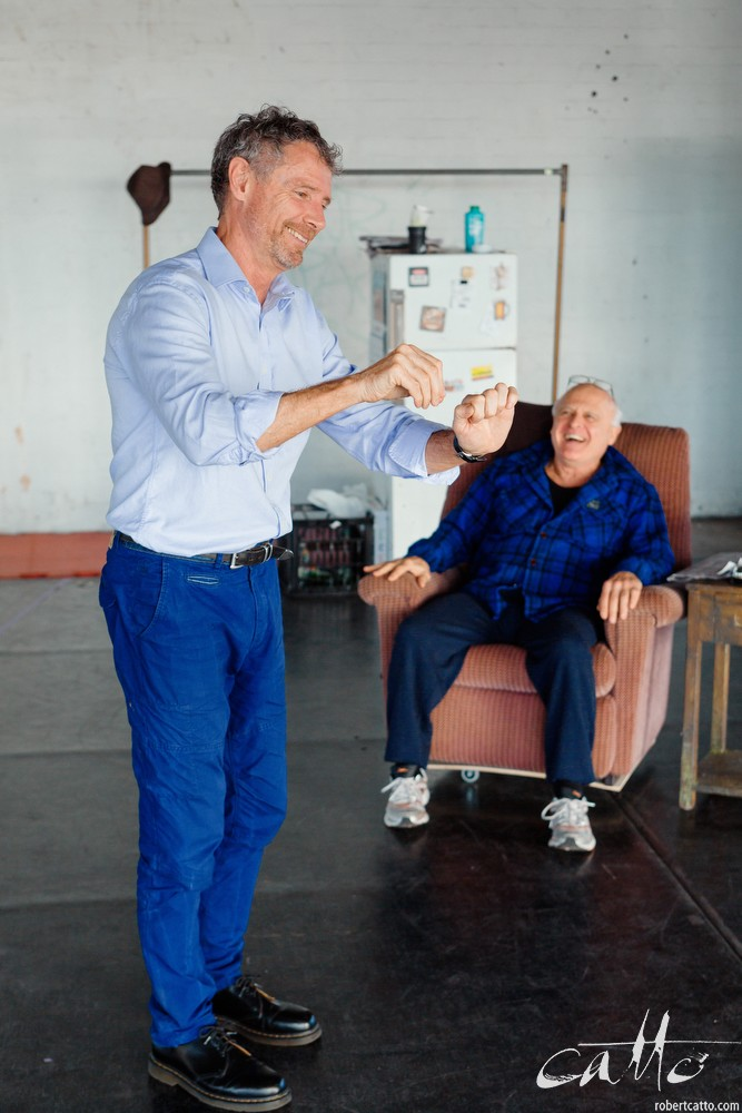 Danny Adcock, Noel Hodda, Jamie Oxenbould & Richard Sydenham rehearse with director Glynn Nicholas for Apocalypse Theatre's production of The Dapto Chaser, by Mary Rachel Brown, on Tuesday, 23 June, 2015.  The show takes place at Griffin Theatre from 1 - 15 July, 2015.  Photo by Robert Catto / robertcatto.com.For the Sinclair family, the cut-throat world of greyhound racing is a religion. And their beloved dog Boy Named Sue is more than a greyhound; he's their heart and soul on four legs. With the crucial Winnebago Classic on the horizon, Cess Sinclair has one shot at reversing his family's fortunes for good. Against all the odds, he's betting on a miracle.The Dapto Chaser is warts-and-all Australian comedy that gets its hands dirty with the adrenaline, sweat and guts of the dog racing sub-culture. The Sinclairs are a family trapped in the pressure cooker of gambling addiction and when things don't go to plan, they are forced to gamble the most important commodity of all – their relationship to each other.Playwright Mary Rachel Brown wrote The Dapto Chaser perched in the bleachers track-side, while director Glynn Nicholas will be going on an all-schnitzel diet to get it over the line.