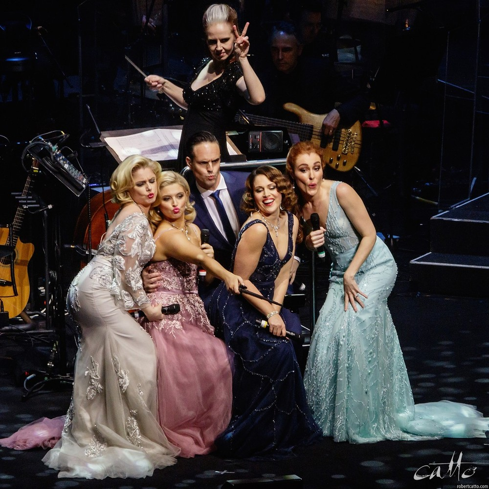 Kellie Dickerson, Helen Dallimore, Lucy Durack, Ben Lewis, Amanda Harrison and Jemma Rix performing on stage with the Sydney Symphony Orchestra. (Has anyone seen this selfie yet?)