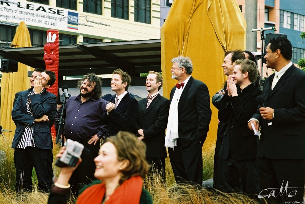 Craig Parker, Orlando Bloom, Peter Jackson, Elijah Wood, Billy Boyd, Barrie Osborne, Hugo Weaving, Dominic Monaghan, and host Jay Lagaia at the Lord Of The Rings: Fellowship Of The Ring Premiere at the Embassy Theatre, Wellington, New Zealand.