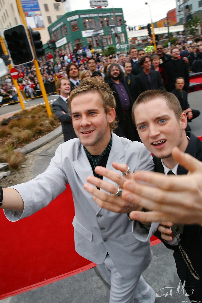 The Lord Of The Rings: The Two Towers premiere in Wellington, New Zealand. - Dominic Monaghan and Elijah Wood chase the camera on Courtenay Place.