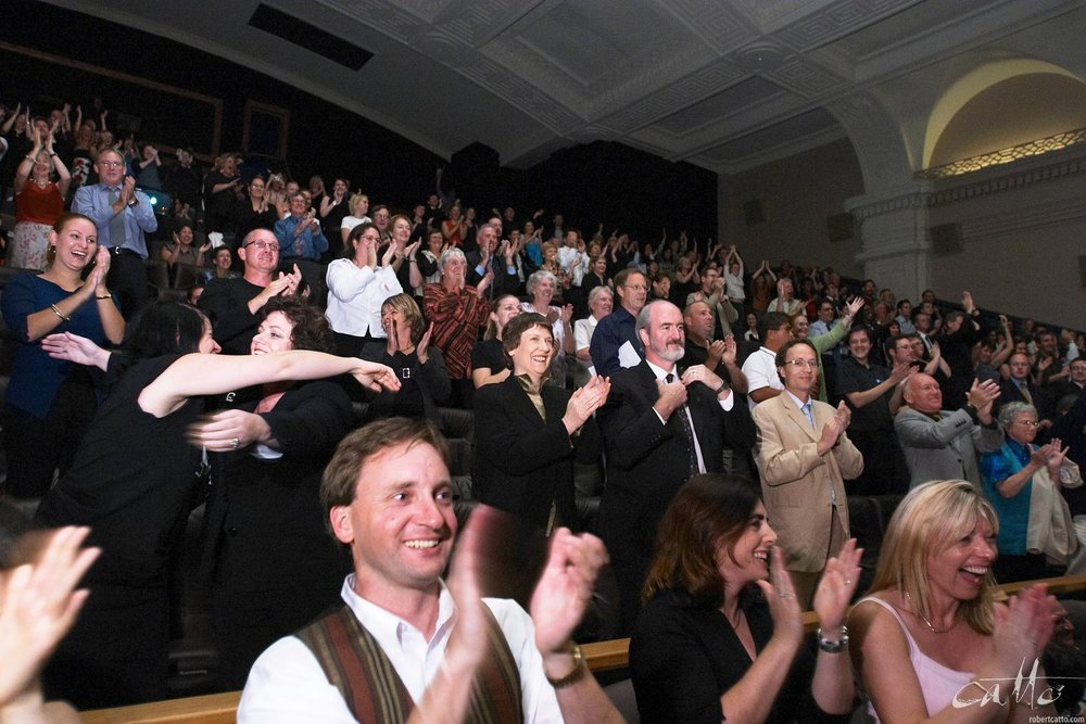 Crowds at the Embassy Theatre give a standing ovation as The Lord Of The Rings: The Return Of The King sweeps the Oscars, broadcast live from Los Angeles.