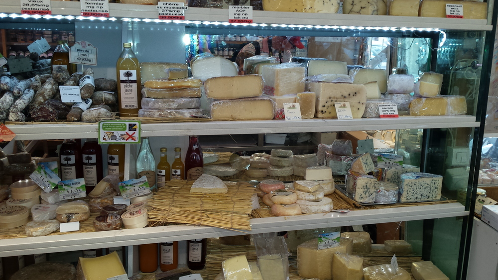 Wall of cheese. There's my brie on the straw mat.