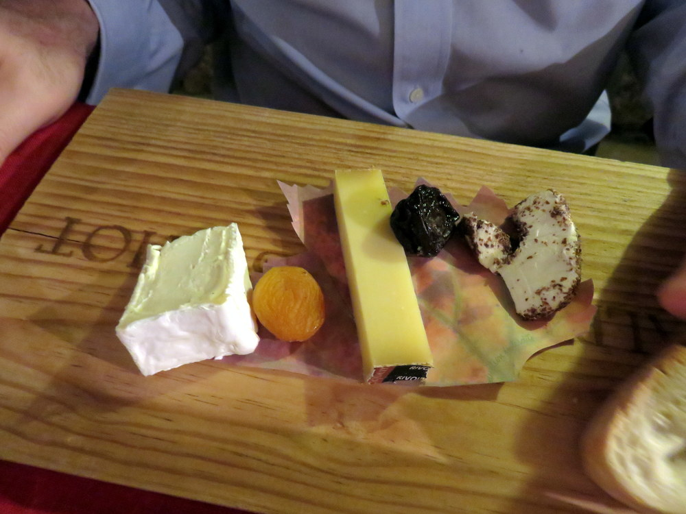 Brillat-Savarin on the left, Délice de Pommard on the right, Comté in the middle. This is the cheese plate from  Le Conty in Beaune , where we ate in the wine cave and had an  outstanding  meal.