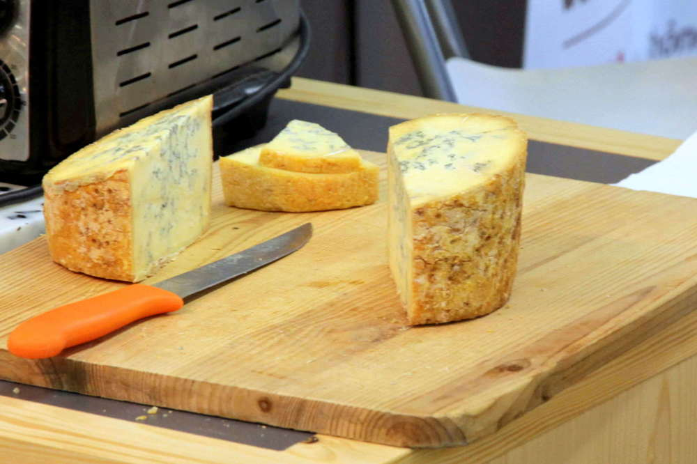 Montbrison has an orange rind & is a bit drier than Fourme d'Ambert