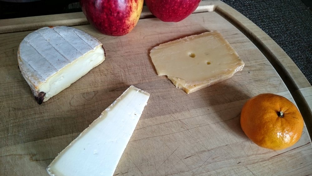 A smoky nutty Claousou (top left), Tomme de Saulnois with a plum brandy-washed rind (top right), and a mild delicious Cône du Colombier