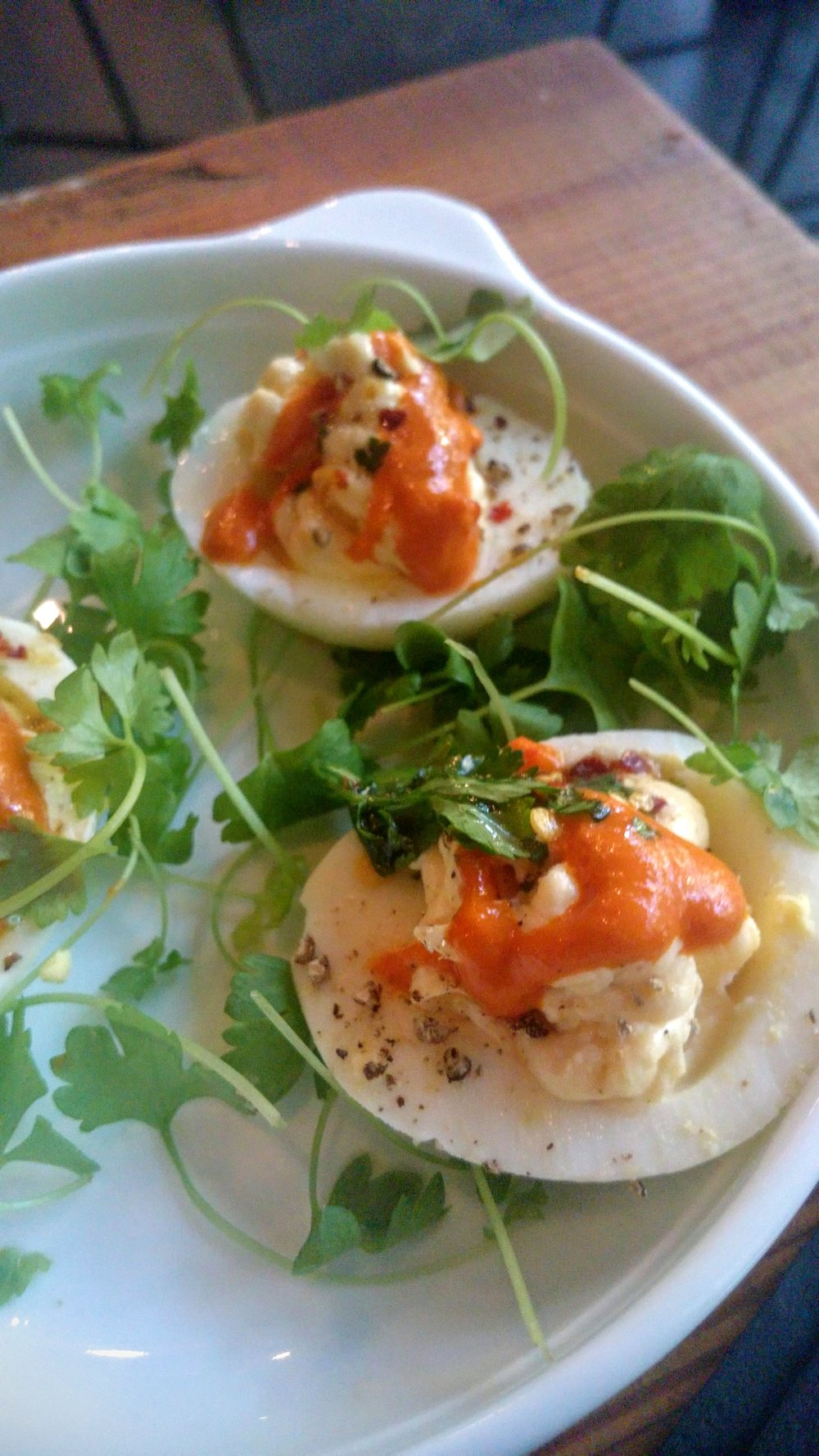 Deviled eggs with sriracha.