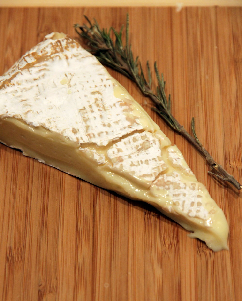 A well-ripened brie has a crust that's more mottled. Its paste will be a bit shiny.