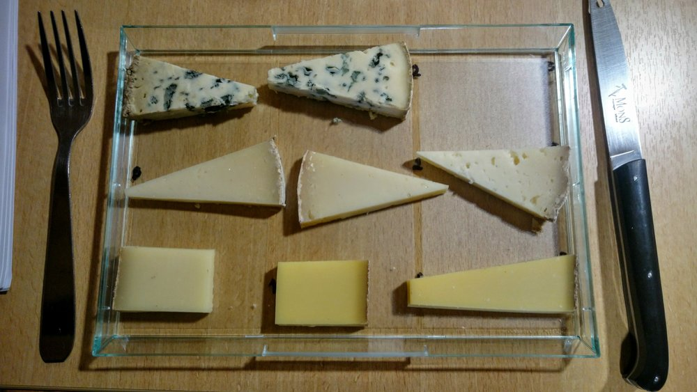 Another example of the same cheeses in each row at different ages. Age will make rinds grow thicker and more rustic and rugged. Paste will typically darken in pressed cheeses. The top row is called 1924 and is a blue cheese of mixed cow and sheep's milk. The middle is the tomme du Mon Pilat, a goat cheese. The bottom row is comté. Interestingly here, the left-most comté is about 7 months older than the middle cheese, which may be due to the fact that the middle cheese was made at the end of the milking season, when the milk typically has a lower water content.