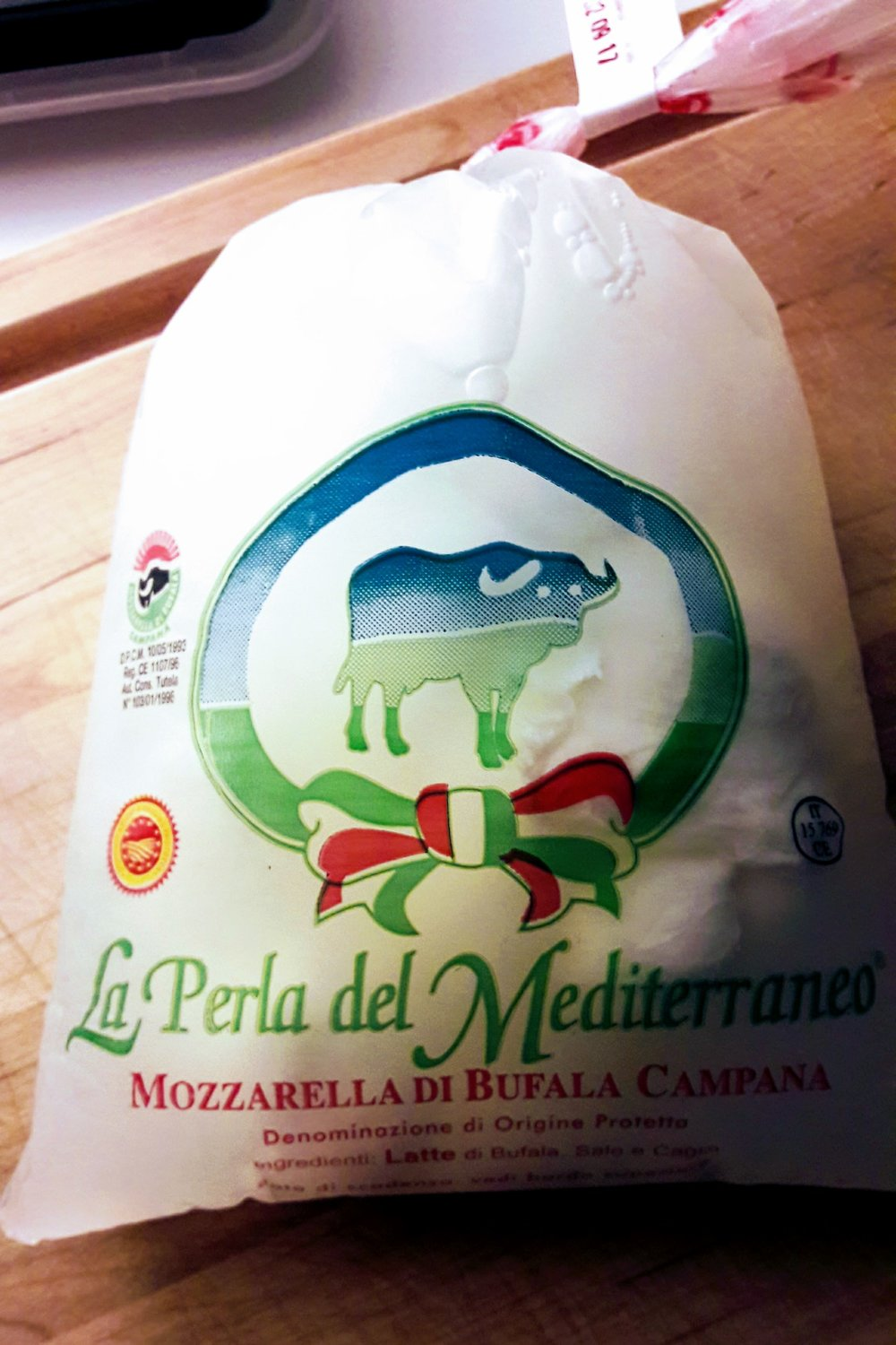 Fresh mozzarella in its brine. This one was made not far from the Mediterranean Sea in the Italian region of Campania, not far from the gorgeous Amalfi coast.