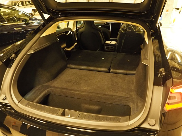 New Black P85: Hatchback door open, rears seats folded down, and extra space exposed (no child seats installed)