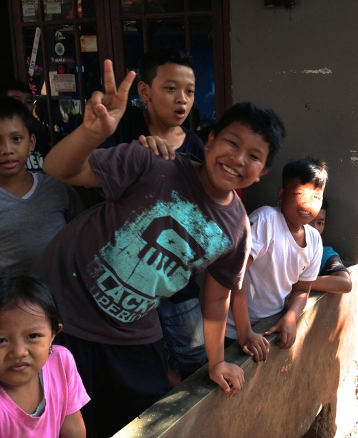 Some of the neighborhood kids near one of the volunteer projects
