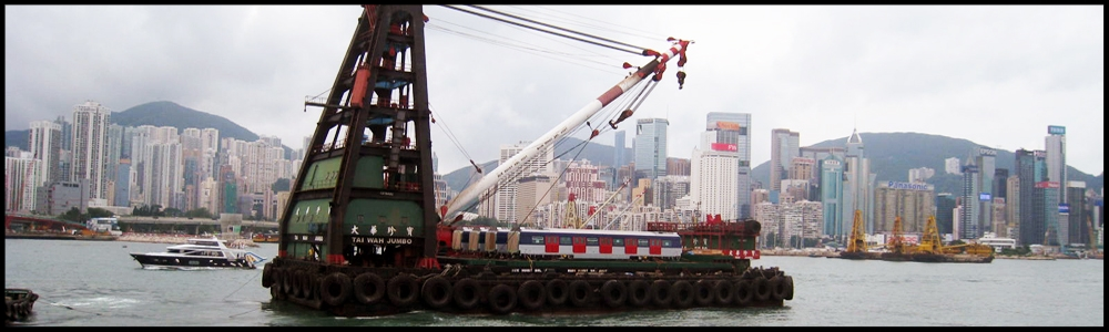 MTR No.1151 project - Utilizing multiple special extendible trailers, floating crane, tug boats and special equipment to provide a complete delivery solution for new railcar import from Japan. Scope including lifting, barge delivery and inland transport.