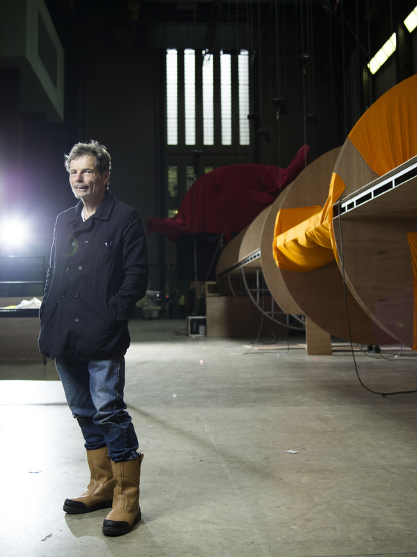 Richard Tuttle poses during construction of his installation in the turbine hall of the Tate Modern gallery.