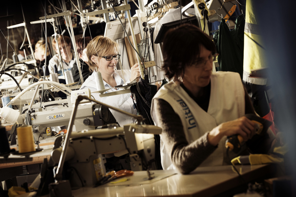 Seamstress Martine Wauters at the Rentokil-Initial Lokeren Laundry, Belgium. Martine is part of a team of 8 dedicated seamstresses who ensure that all workwear garments are expertly repaired as quickly as possible so that they can be returned to the customer with the rest of their regular laundry service.