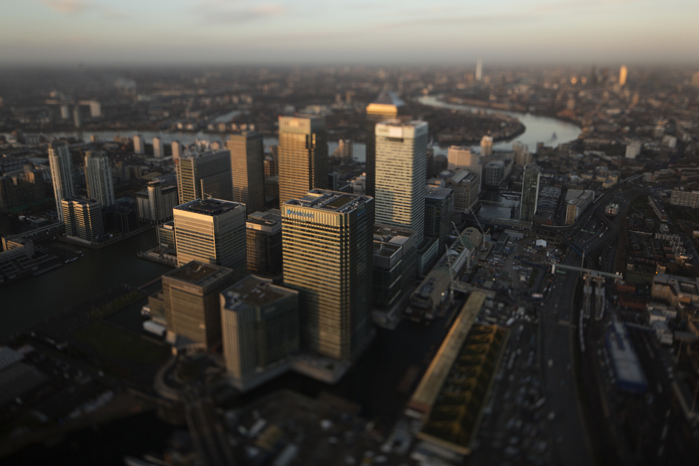 No. 1 Canada Square stands surrounded by the offices of global financial institutions, including HSBC Holdings Plc, Citigroup Inc., JPMorgan Chase & Co., and Barclays Plc, in this aerial photograph taken with a tilt-shift lens looking west along the River Thames towards the City of London from the Canary Wharf business and shopping district in London in London, U.K., on Thursday, Dec. 19, 2013. The pound approached a two-year high versus the dollar after Bank of England policy maker Andrew Bailey said the central bank may take steps to prevent U.K. house prices from rising too quickly. Photographer: Matthew Lloyd/Bloomberg via Getty Images