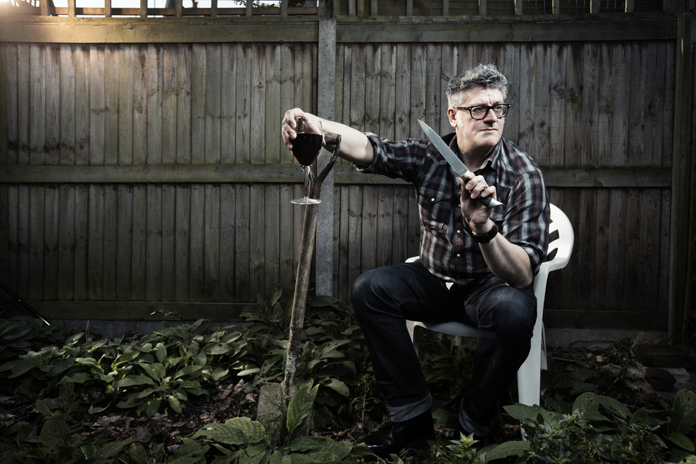 Crime thriller author Martyn Waites poses in his back garden for a magazine article.