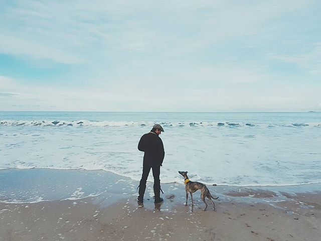 Florence and myself at the beach.  #landscape #wanderlust #nature #landscapephotography #filsonlife #england #beach #coast #naturelover #tweed #fashion #blueskies #purdey #stetson #beach #wilderness #edinburgh #dogsofinstagram #britain #hibernot #agoodwalk #gonefishing #coast #android #samsung #whippet #northumberland #bamburgh #whippetsofinstagram #northeast