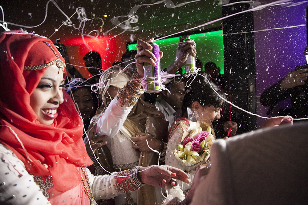 The Silly String  Much to my surprise, and with no warning, the brides familybroke out the silly string and the doorway erupted in screaming andlaughter, and well, string all over the place!