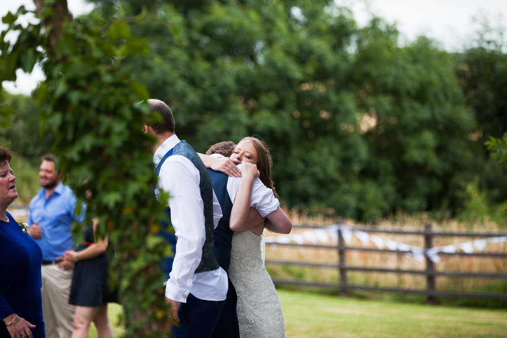 bride hugs brother
