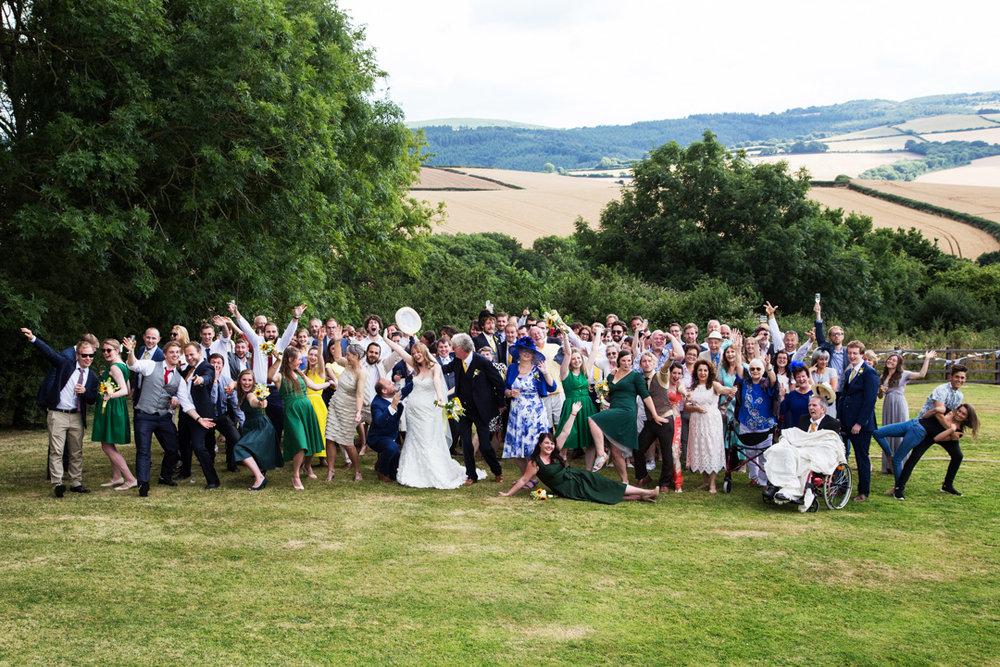 full wedding party do crazy pose