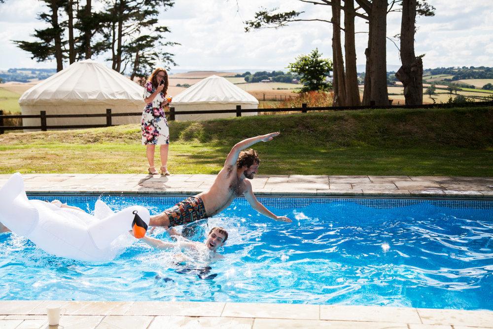 groomsman in swimming pool