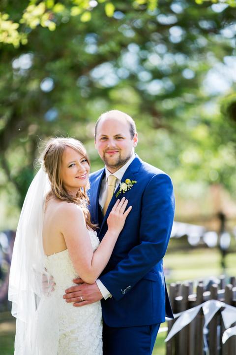 bride and groom pose Higher Eggbeer