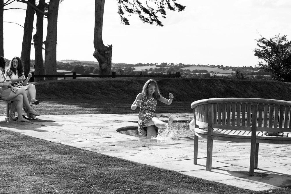 wedding guest splashes water