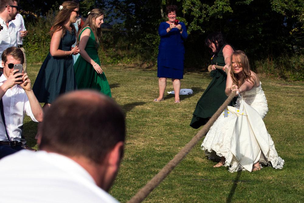 bride and groom tug of war