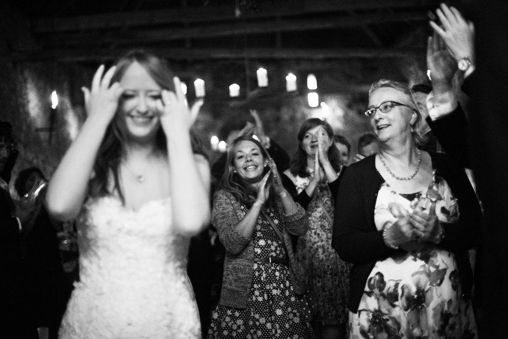 crowd applauding bride