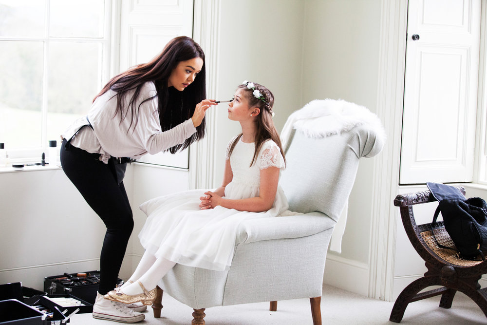 flower girl having makeup done by Mac Makeup girl