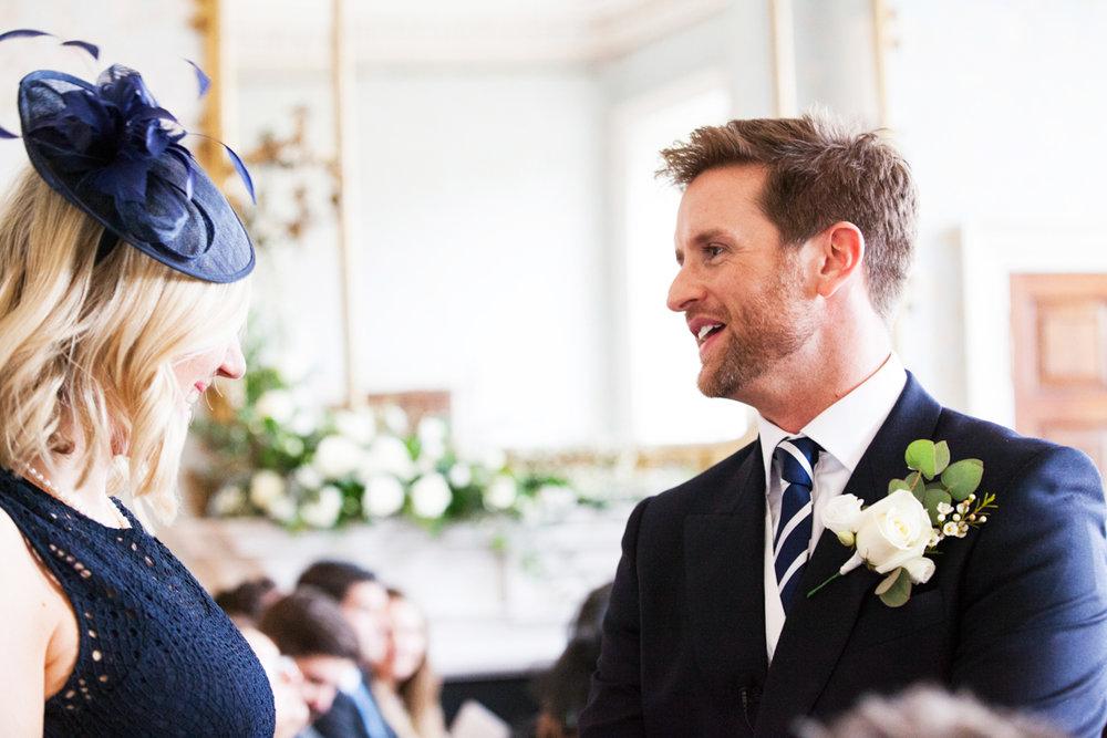 groom greeting guests
