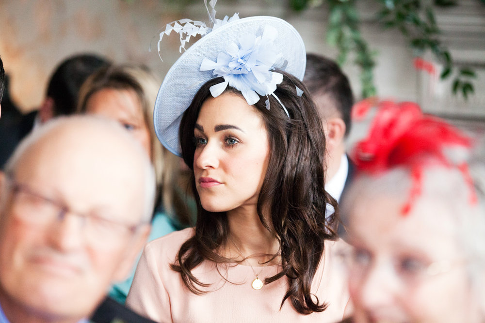wedding guest wearing blue fascinator