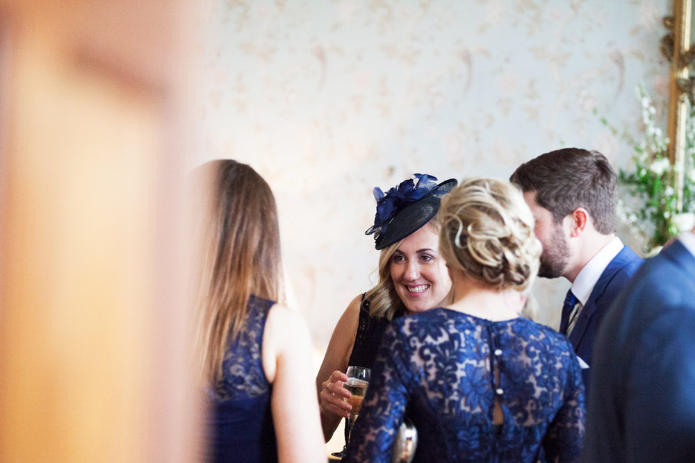 wedding guests in navy blue