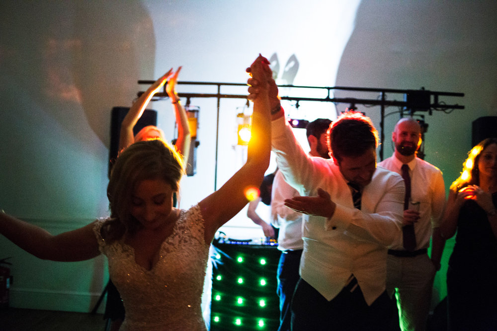 bride and groom take a bow at disco