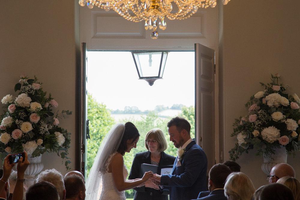 bride and groom exchange rings Kingston Estate