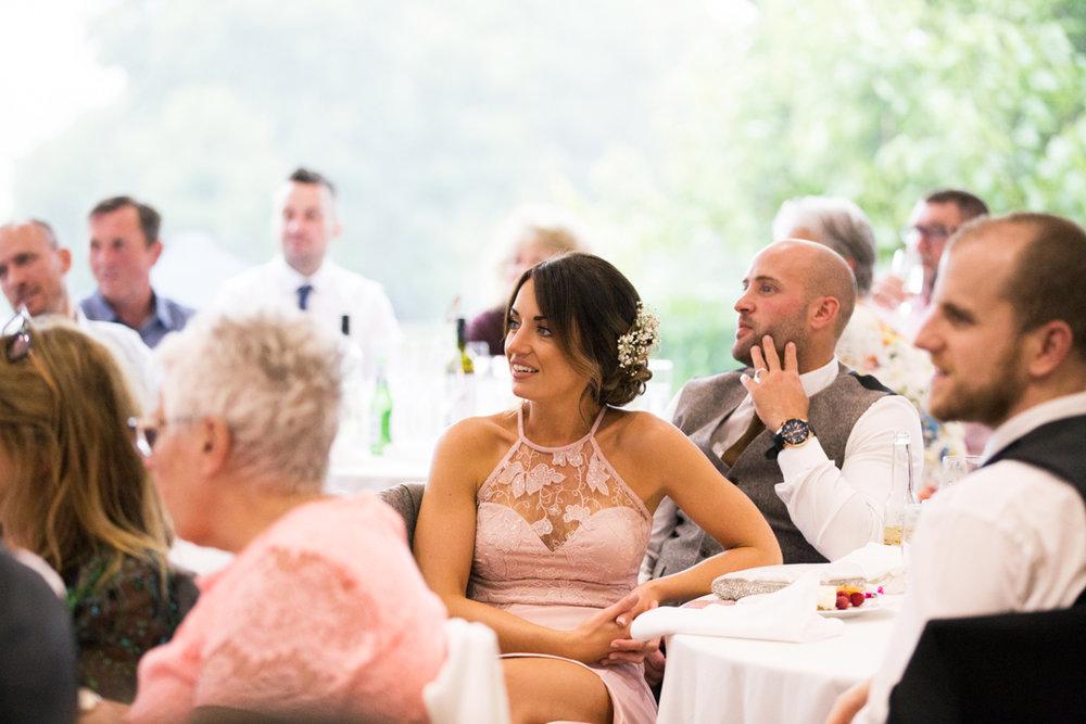 bridesmaid listens during speeches Kingston Estate