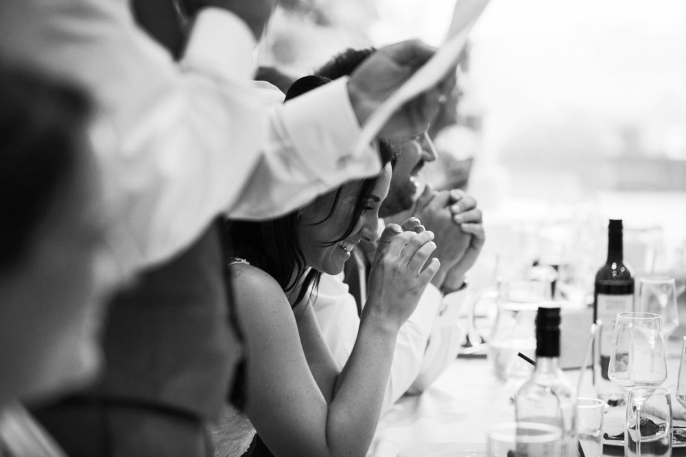bride laughs at wedding speech