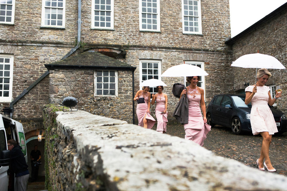 bridesmaids holding umbrellas Kingston Estate