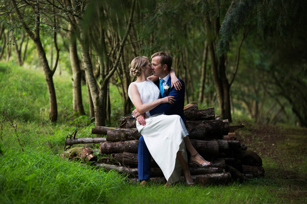 kissing on log pile