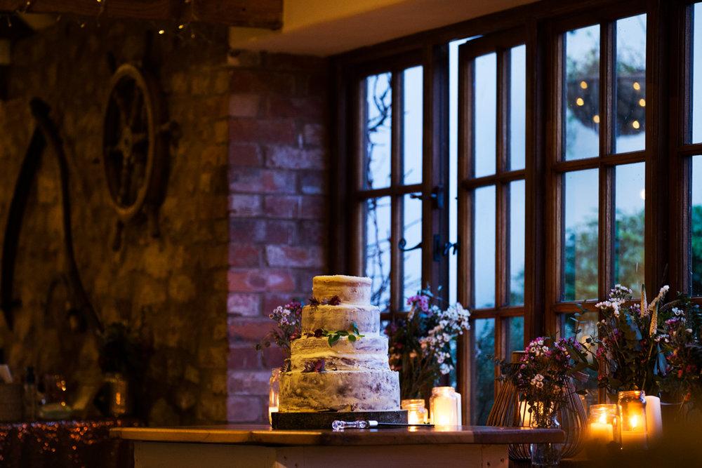 candle lit wedding cake
