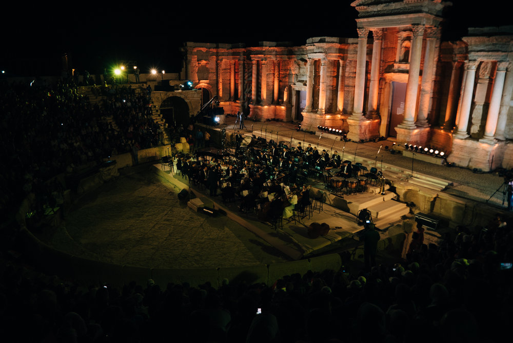 The Syrian National Orchestra plays in the Roman amphitheater at Palmyra to mark the site's liberation from ISIS and commemorate the Syrian Army soldiers executed on it's stage months before. | Palmyra - May 2016