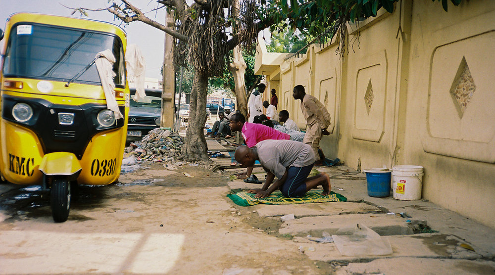 Men break to pray Asr during Ramadan. | Kano, Nigeria - June 2016