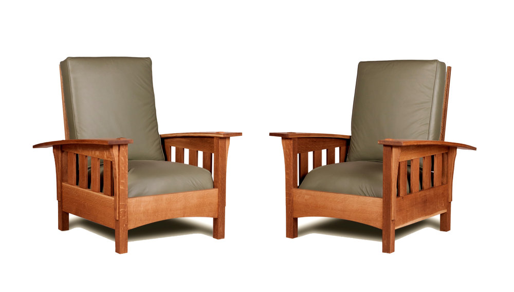 TWO OF EIGHT MORRIS CHAIRS MADE FOR DELBARTON MONASTERY IN NEW JERSEY.