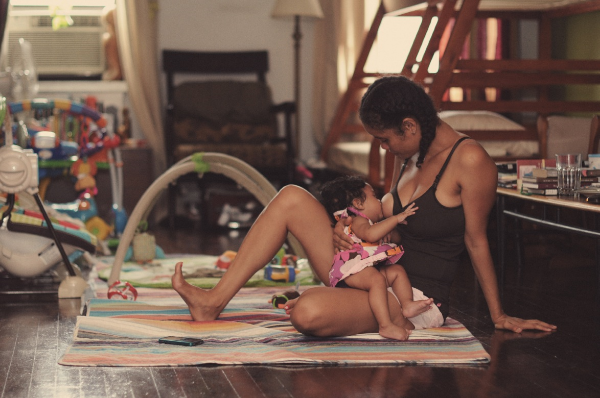 Poet and activist  Staceyann Chin  breastfeeding her daughter Zuri. Photo credit: J. Quazi King