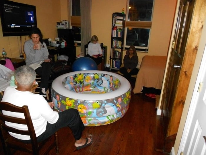 The kiddie pool was set up in the family's living room.