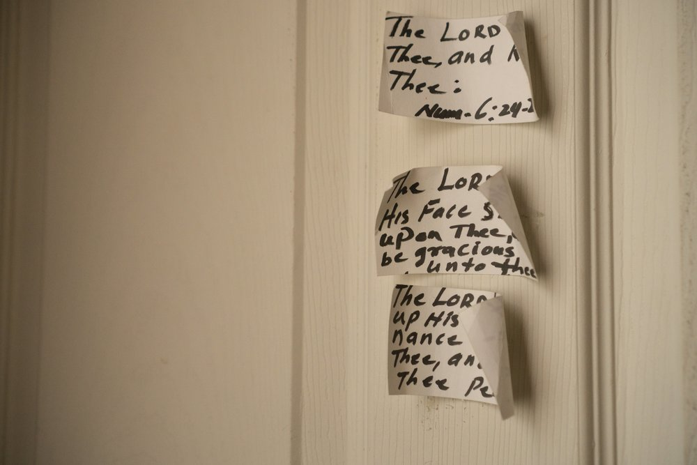 Scripture on the front door of Janel's parents' house in Brooklyn where she's currently living.