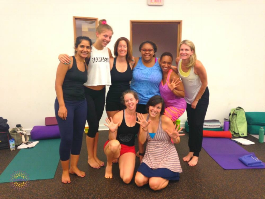 Tosh (top row) during her yoga training.
