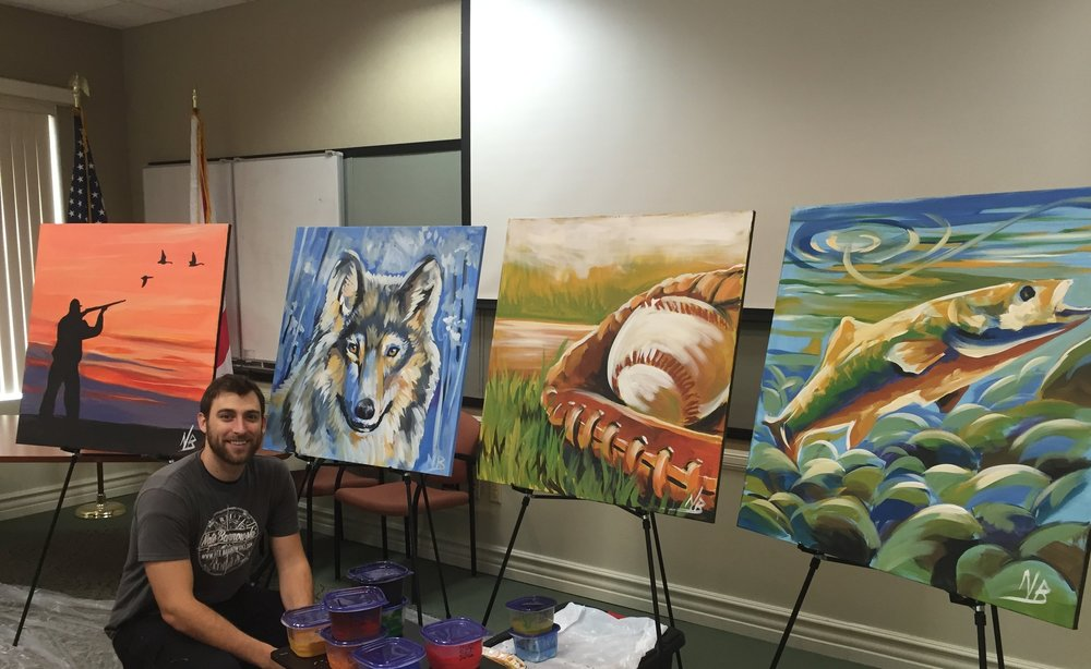 Nate with four 3'x3' speed paintings performed for a corporate event.